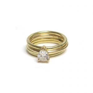 pear diamond 18K gold engagement ring stack