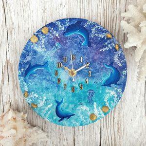 Dolphin and jellyfish underwater scene wall clock
